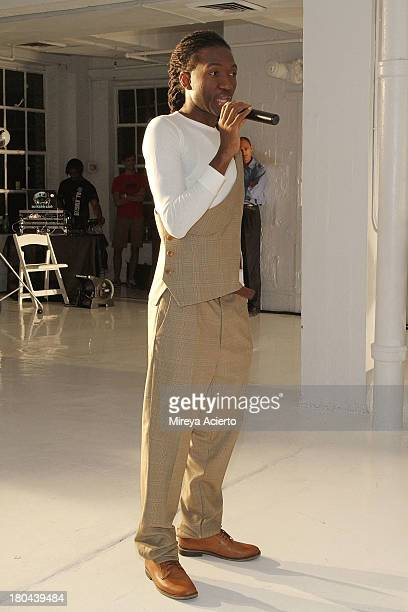 Darius Wobil speaks to guests at the St Wobil fashion show during MercedesBenz Fashion Week Spring 2014 at The Designer's Loft at Studio 450 on...
