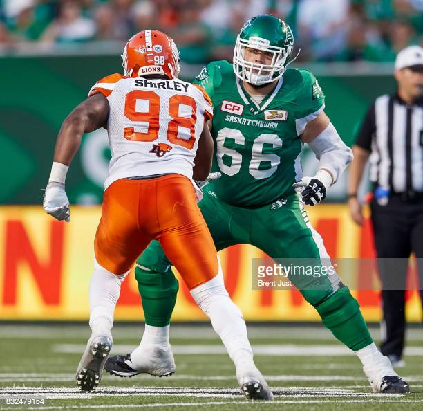 Dariusz Bladek of the Saskatchewan Roughriders looks to block Josh Shirley of the BC Lions in the game between the BC Lions and the Saskatchewan...