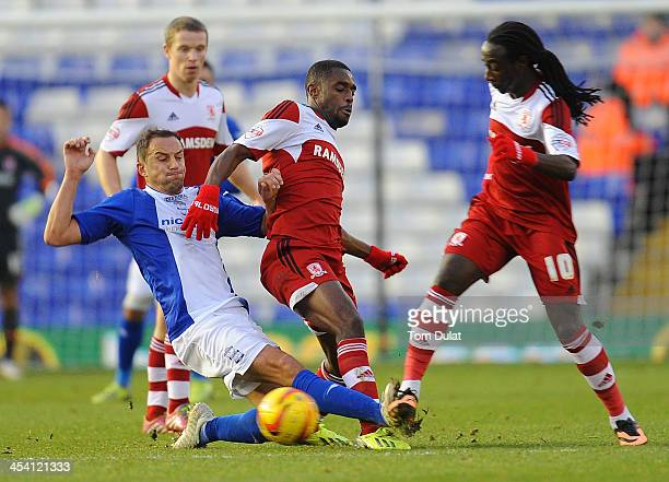 Dariusz Dudka of Birmingham City together with Mustapha Carayol and Marvin Emnes of Middlesbrough battle for the ball during the Sky Bet Championship...