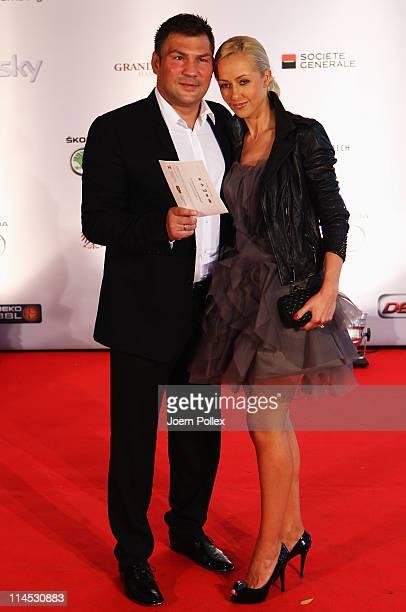Dariusz Michaelsewski and his girlfriend arrive for the Herbert Award 2011 Gala at the Elysee Hotel on May 23 2011 in Hamburg Germany
