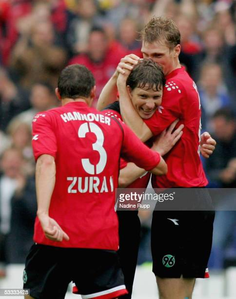 Dariusz Zuraw Michael Tarnat and Per Mertesacker of Hanover celebrate Michael Tarnat scoring the the second and equalising goal during the Bundesliga...