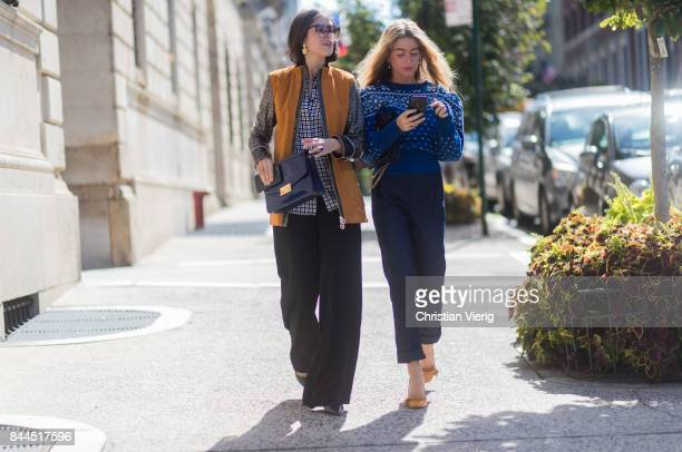 Darja Barannik and Emili Sindlev wearing blue knit navy cropped pants seen in the streets of Manhattan outside Tory Burch during New York Fashion...