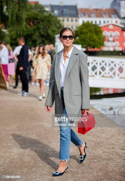 Darja Barannik is seen wearing grey blazer denim jeans red Boyy bag heels outside Blanche during Copenhagen Fashion Week Spring/Summer 2020 on August...