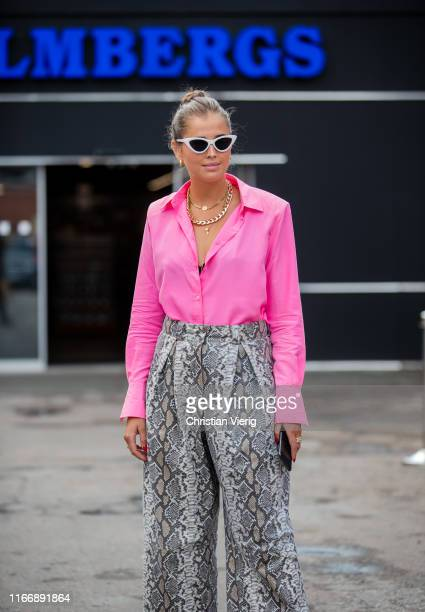 Darja Barannik is seen wearing pink button shirt, pants with snake print outside By Malene Birger during Copenhagen Fashion Week Spring/Summer 2020...
