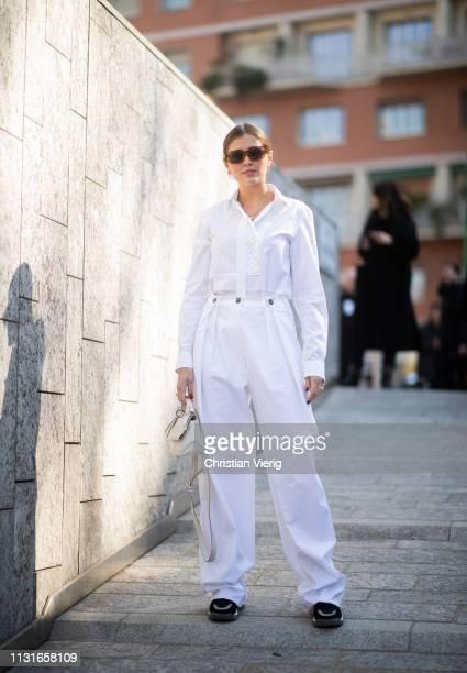 Darja Barannik is seen wearing white pants button shirt outside Sportmax on Day 3 Milan Fashion Week Autumn/Winter 2019/20 on February 22 2019 in...