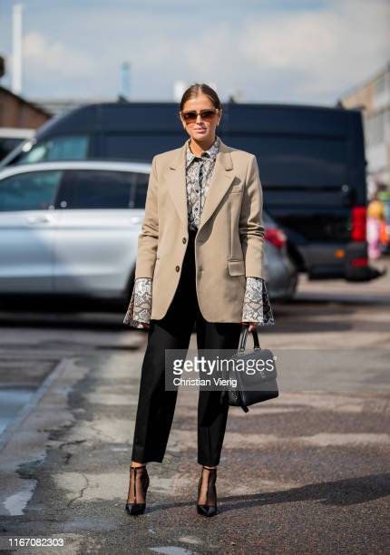 Darja Barannik seen wearing beige blazer button shirt with snake print Chanel bag outside Baum und Pferdgarten during Copenhagen Fashion Week...