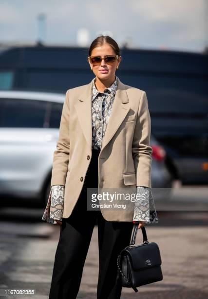 Darja Barannik seen wearing beige blazer button shirt with snake print Chanel bag outside Baum und Pferdgarten during Copenhagen Fashion Week...