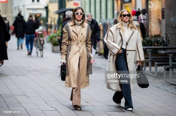 Darja Barannik seen wearing beige brown two tone coat and Tine Andrea wearing turtleneck black bag oversized coat outside Mark Kenly Domino Tanduring...