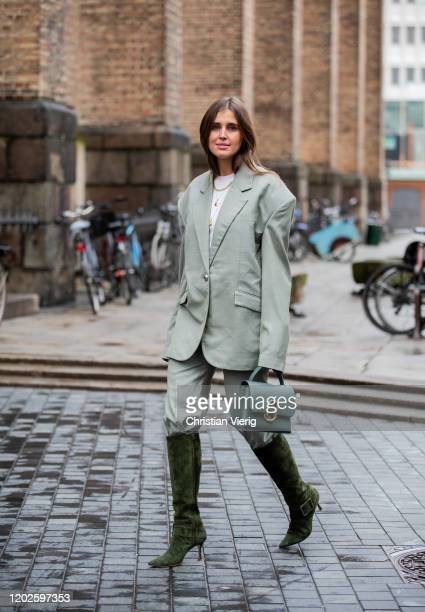 Darja Barannik seen wearing oversized blazer, pants, green boots, green bag outside Blanche on Day 1 during Copenhagen Fashion Week Autumn/Winter...