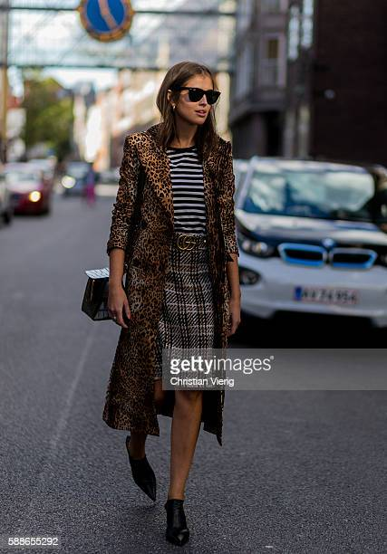 Darja Barannik wearing a coat with leo print and mules and Gucci belt outside Baum und Pferdgarten during the second day of the Copenhagen Fashion...