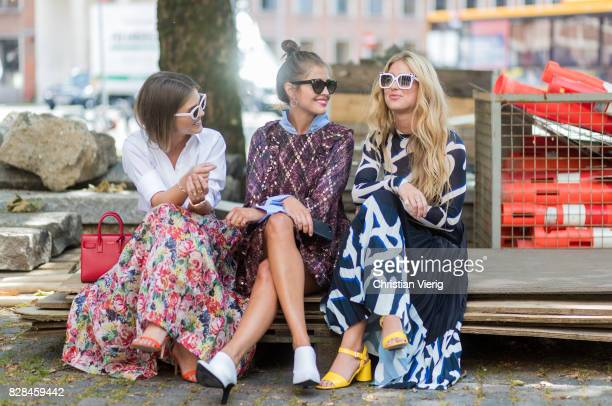 Darja Barannik wearing a dress and Emili Sindlev talking outside Munthe on August 09 2017 in Copenhagen Denmark