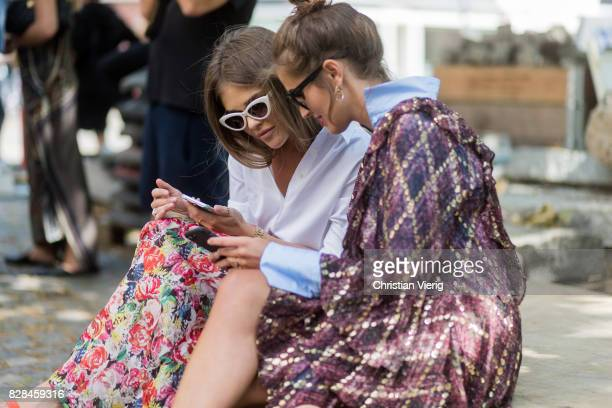 Darja Barannik wearing a dress checking the phone with a friend outside Munthe on August 09 2017 in Copenhagen Denmark