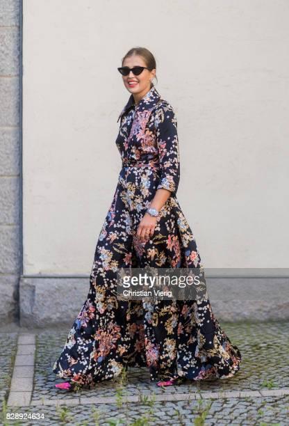 Darja Barannik wearing a dress with floral print, Balenciaga boots outside Holzweiler on August 09, 2017 in Copenhagen, Denmark.