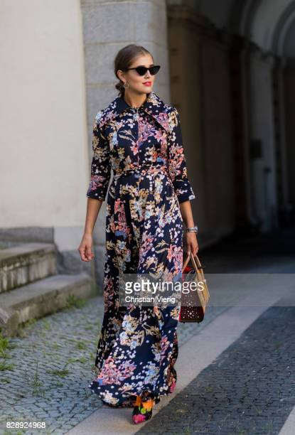 Darja Barannik wearing a dress with floral print, Balenciaga boots outside Holzweiler on August 09, 2017 in Copenhagen, Denmark.