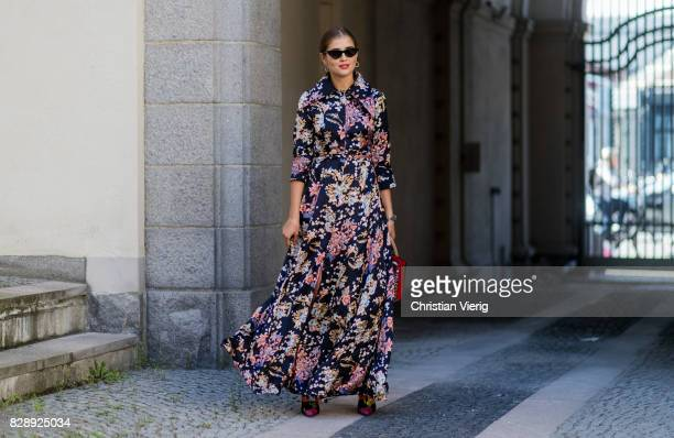 Darja Barannik wearing a dress with floral print Balenciaga boots outside Holzweiler on August 09 2017 in Copenhagen Denmark