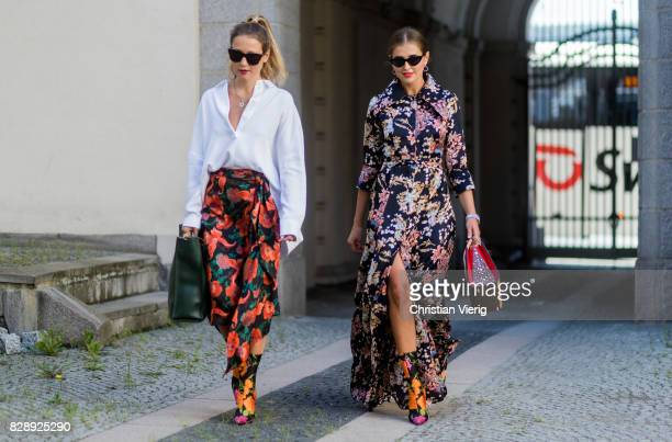 Darja Barannik wearing a dress with floral print Balenciaga boots outside Holzweiler on August 09 2017 in Copenhagen Denmark