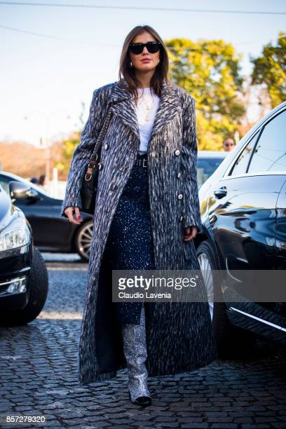 Darja Barannik wearing a grey coat Chanel glitter boots Chanel bag and a Chanel dress is seen before the Chanel show during Paris Fashion Week...