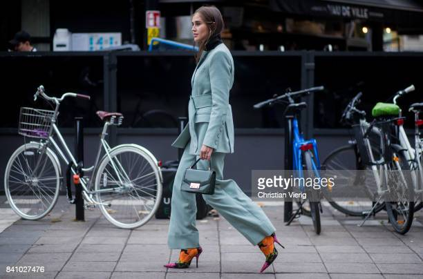 Darja Barannik wearing a pastel suit outside Rodebjer on August 30 2017 in Stockholm Sweden