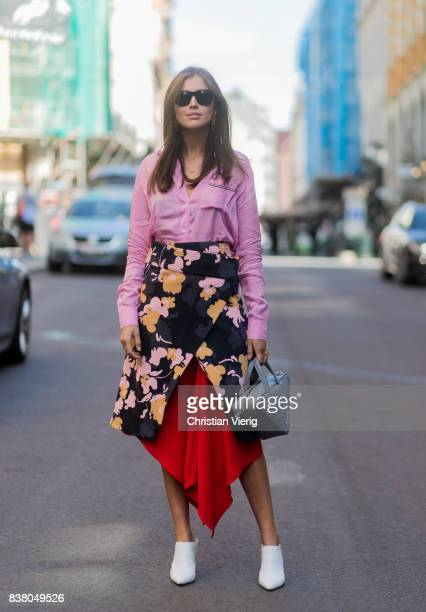 Darja Barannik wearing a skirt with floral print pink blouse grey Balenciaga bag outside iis Woodling on August 23 2017 in Oslo Norway