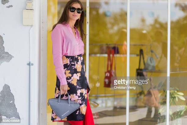 Darja Barannik wearing a skirt with floral print pink blouse grey Balenciaga bag outside Cala Jade on August 23 2017 in Oslo Norway