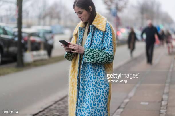 Darja Barannik wearing a yellow blue coat PVC pants outside Munthe during the Copenhagen Fashion Week Autumn/Winter 17 on February 2 2017 in...