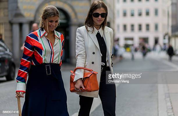 Darja Barannik wearing an orange Loewe bag and white blazer and Janka Polliani wearing a Celine shirt and pink Gucci bag outside Fonnesbech during...
