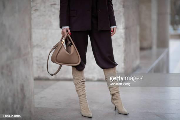 Darja Barannik wearing bordeaux blazer pants beige boots Boyy bag outside Cédric Charlier during Paris Fashion Week Womenswear Fall/Winter 2019/2020...