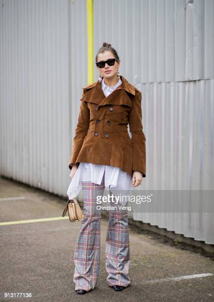 Darja Barannik wearing brown jacket flared checked pants outside Designers Remix during the Copenhagen Fashion Week Autumn/Winter 18 on February 1...