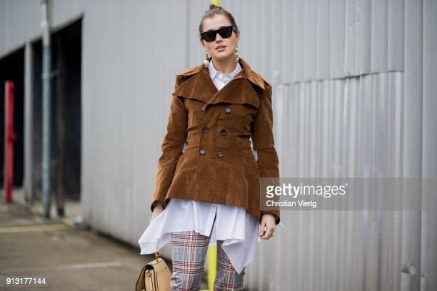 Darja Barannik wearing brown jacket flared checked pants outside Designers Remix during the Copenhagen Fashion Week Autumn/Winter 18 on February 1...