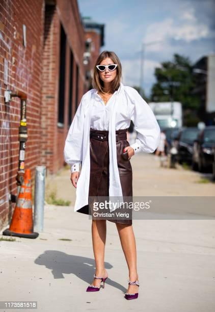 Darja Barannik wearing brown skirt with slit, white blouse seen outside 3.1 Phillip Lim during New York Fashion Week September 2019 on September 09,...