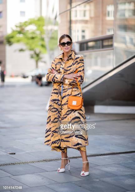 Darja Barannik wearing coat with leopard print is seen outside Designers Remix during the Copenhagen Fashion Week Spring/Summer 2019 on August 9 2018...
