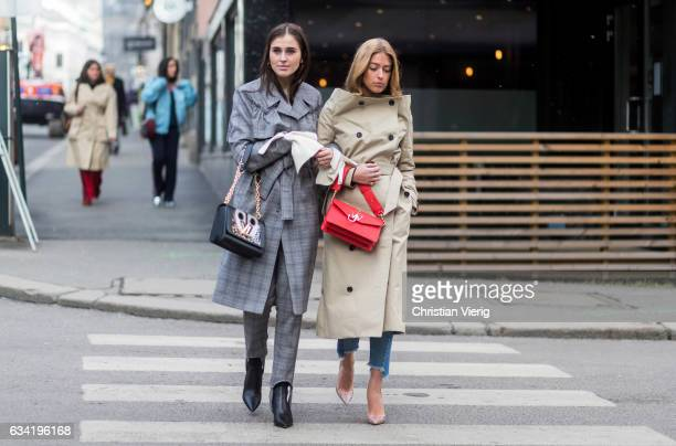 Darja Barannik wearing Designers Rmx coat Louis Vuitton bag and Emili Sindlev wearing a red JW Anderson bag trench coat on February 7 2017 in Oslo...