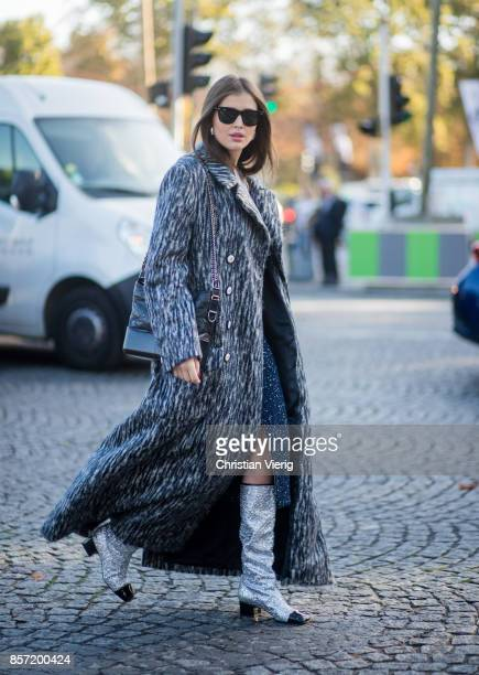 Darja Barannik wearing grey coat Chanel glitter boots Chanel bag Chanel dress seen outside Chanel during Paris Fashion Week Spring/Summer 2018 on...