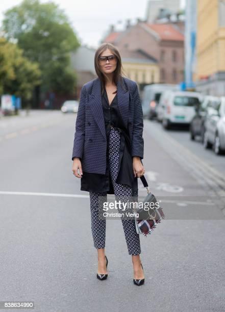Darja Barannik wearing grey jacket JW Anderson bag outside Vanessa Rudjord on August 24 2017 in Oslo Norway