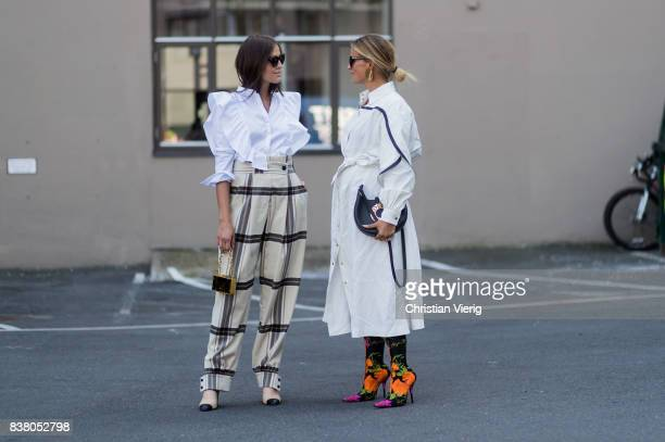 Darja Barannik wearing plaid pants and Janka Polliani wearing Loewe bag white dress Balenciaga sock boots outside FWSS on August 23 2017 in Oslo...