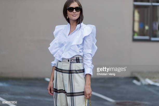 Darja Barannik wearing plaid pants white blouse outside FWSS on August 23 2017 in Oslo Norway