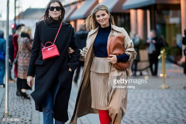 Darja Barannik wearing red Hermes bag and Janka Polliani wearing trench coat Loewe bag is seen outside Designers Nest during the Copenhagen Fashion...