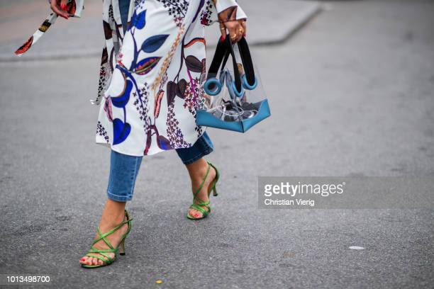 Darja Barannik wearing see trough bag is seen outside Stine Goya during the Copenhagen Fashion Week Spring/Summer 2019 on August 8 2018 in Copenhagen...