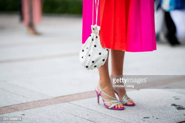 Darja Barannik wearing white bag with dots print and pink dress is seen outside Line of Oslo during Oslo Runway SS19 on August 15 2018 in Oslo Norway