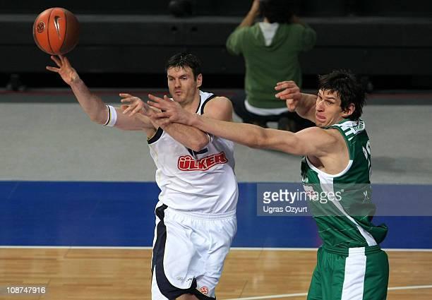 Darjus Lavrinovic, #12 of Fenerbahce Ulker Istanbul competes with Boban Marjanovic, #22 of Zalgiris Kaunas competes during the 2010-2011 Turkish...