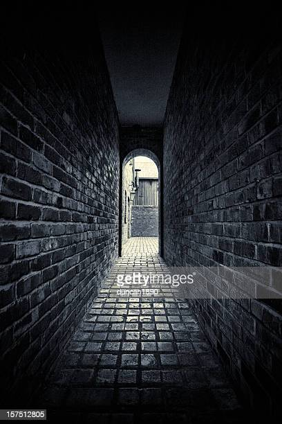 dark alley - black alley stock photos and pictures
