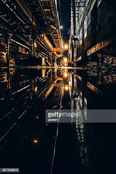Dark alley reflected in puddle. Wicker Park, Chicago.
