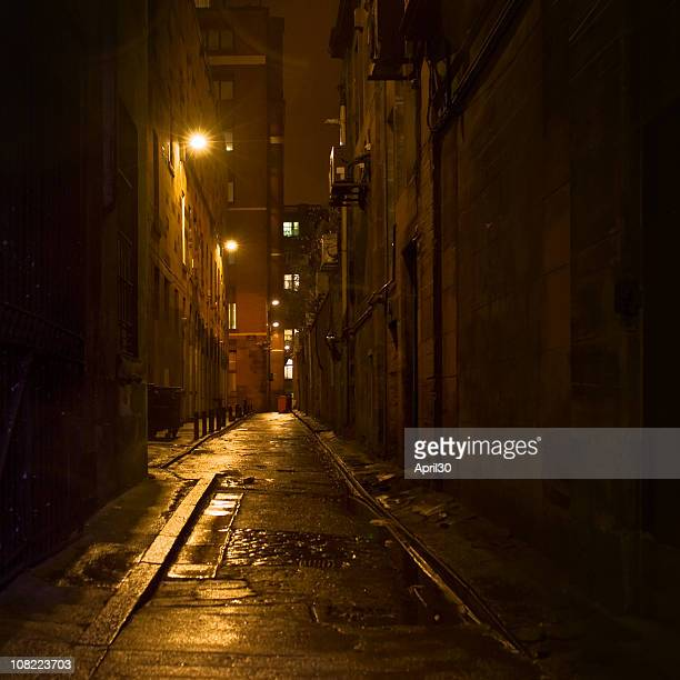 dark alleyway with light in downtown glasgow - alley stock photos and pictures