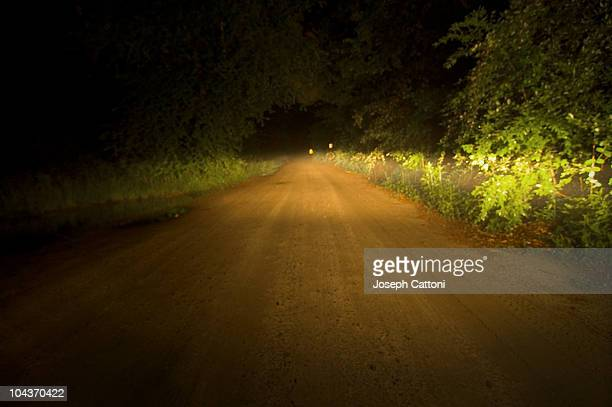 dark and lonely road - roswell stock pictures, royalty-free photos & images