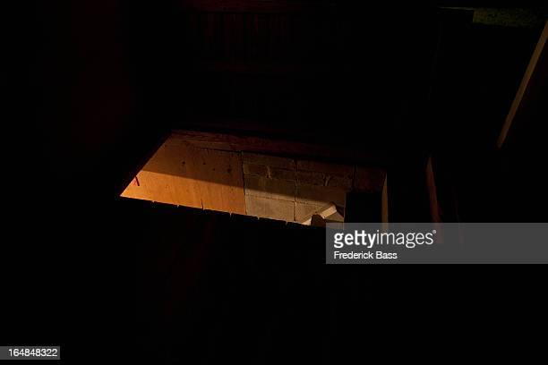 Dark attic with light seen through door