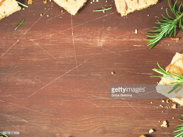 dark background with rosemary cookies - theobroma stock photos and pictures