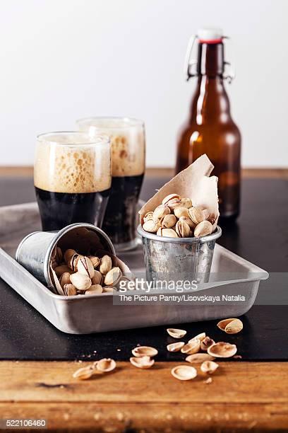 Dark beer and salted pistachios