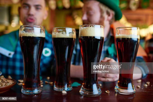 dark beer in glasses - st patricks day stock pictures, royalty-free photos & images