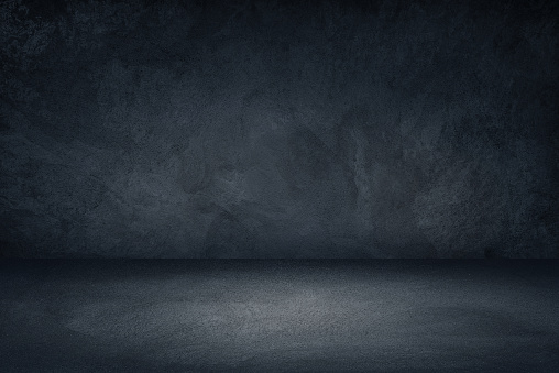 Dark black and blue grungy wall background for display or montage of product 1150477705