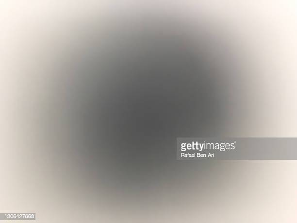 dark black hole glowing on white background - rafael ben ari fotografías e imágenes de stock